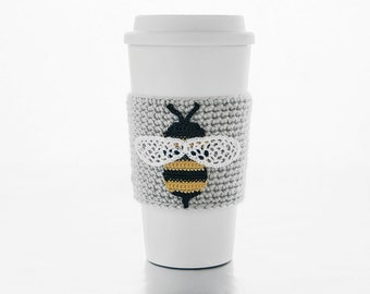 Busy Bumblebee, cup cozy, coffee sleeve, crochet bee applique, linen colored sleeve, black and yellow bee, white wings, beehive escapee
