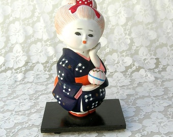 Japanese Girl, Hakata Bisque Ningyo (Doll), unusual hand-painted clay doll with a temari ball, collectible international doll