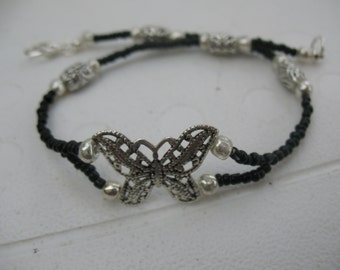 Silver butterfly and glass beads anklet