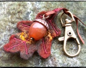 Oak Acorn Charm. Woodland inspired. Hand felted, red Agate stone, Vintaj brass details. Perfect for attaching to bags / keys etc...