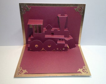 Pop Up 3D TRAIN LOCOMOTIVE Greeting CARD Home Décor Handmade Cut by Hand Origamic Architecture in Metallic Wine Red and Metallic Gold.