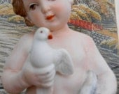 Vintage Porcelain Bisque Cherub holding Dove 9 inch Beautiful marked on bottom