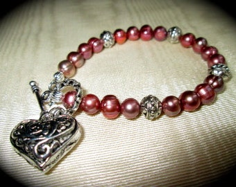 "Pink freshwater pearl bracelet with puffed heart charm 7 1/2"" unusual pink pearls"