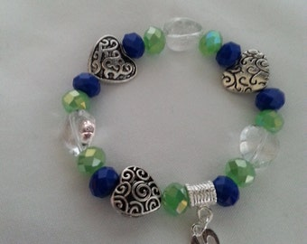 "SUPER BOWL Go Hawks ""12TH Man"" Bracelets. Made to Order in Seahawk Green and Blue. One, Two or Three Strands on Stretch.."