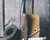 Vintage tobacco pipe tool with repurposed leather sheath & brass hardware.
