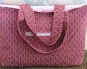 Dark pink zipped tote bag,shoulder bag,handbag,holdall, in textured fabric,with zipped outside pocket and pink lining.