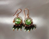 Copper wrapped green glass earrings