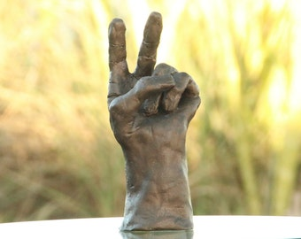Peace, original hand sculpture, bronze finish over white clay
