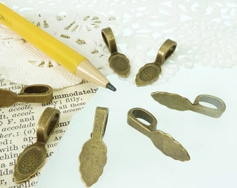 8 antique  bronze glue on flat back bails
