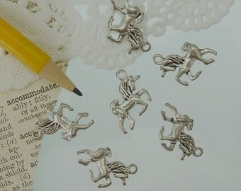 10 unicorn charms in antique silver