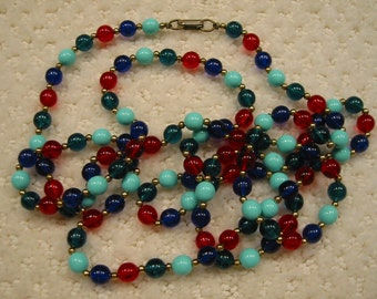 "vintage 1940s . . .  53"" long  . . . .hand strung early plastic bead necklace"