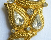 CLEARANCE Rhinestone Vintage Brooch has 4 Wire Twist Styled Paisley Shapes with Pear Shape Rhinestones Centers Plus 5 Accent Rounds.