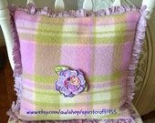 Pillow Vintage upcycled woolen blanket cushion cover with looped fringe. Lime, pink, mauve and cream with embroidered flower in the centre.