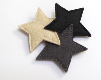 three stars brooch black and white
