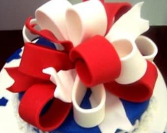 Edible gum paste ribbon bow cake topper