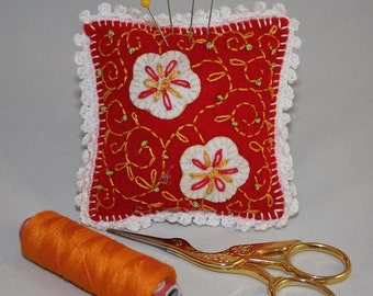 Pincushion - embroidered felt, filigree design red