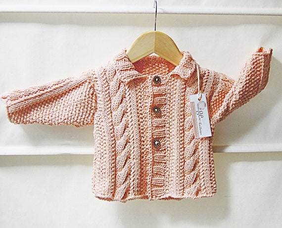 Baby Jacket with cable panels and moss stitch pattern P019
