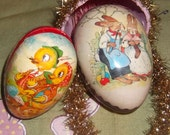 Vintage German egg candy containers one is a mom and dad bunny couple and the smaller egg is a chix family very cute and collectable