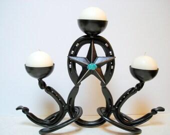 Horseshoe art candle holder