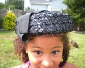 black straw cap with ribbon