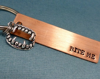 Bite Me - A Hand Stamped Keychain in Aluminum or Copper w/fangs charm