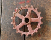 vintage machinery gear red cast metal