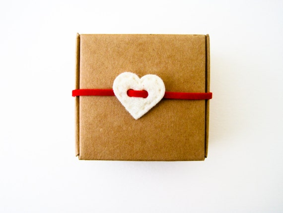 Cardboard box with white heart decoration and British Union jack studs heart shaped