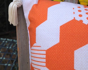 Orange and White Pillow with Hexagonal Pattern