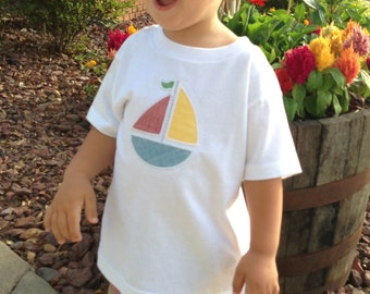 Boys short set with patchwork shorts and sailboat applique.
