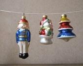 Vintage set of 3 holiday ornaments - glass nutcracker, snowman & tree