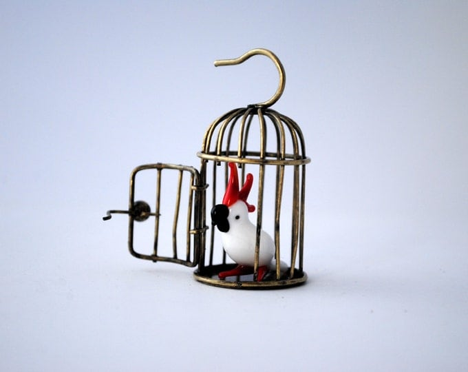 Miniature bird in a cage
