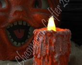 Orange Dripping Candle with flickering tealight