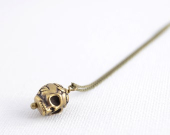 Long simple boho necklace. Small bronze skull necklace.