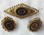 Gold Plated Filigree Victorian Brooch and Matching Clip-On Earrings With Cut Black Glass
