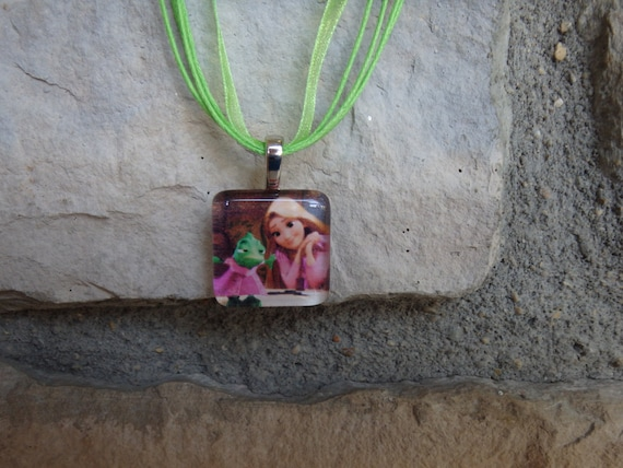The Princess Collection Rapunzel and Pascal from Tangled Glass Pendant and Ribbon Necklace