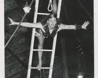 Pretty woman circus acrobat in air vintage photo