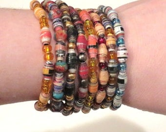 Variety of 10 Paper Bead Bracelets. Wholesale prices, recycled magazine paper beads. Upcycled magazine