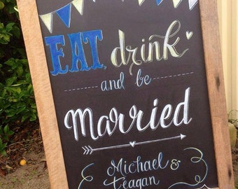 Eat, drink and Be married chalkboard sign.