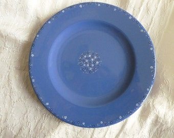 Decorative hand painted ceramic plate / blue with small flowers.