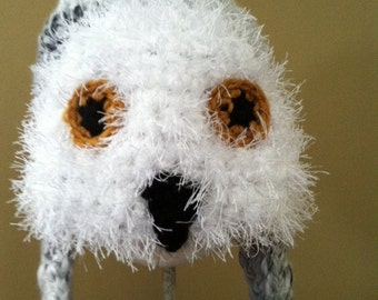 Snowy owl earflap hat for ages 8 to Adult.