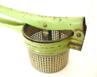 Vintage green potato ricer by Handy Things of Ludington, Michigan