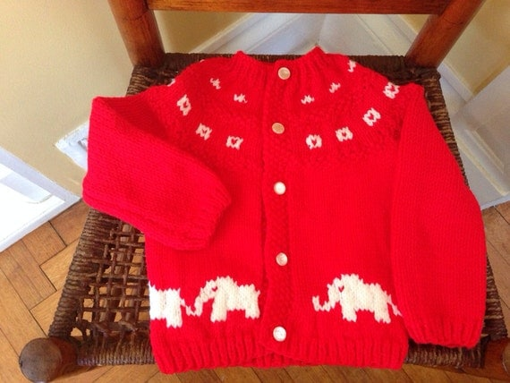 Adorable hand knit child's cardigan sweater with elephant design