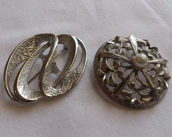 Two vintage white metal brooches