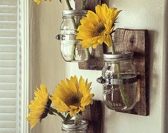 3 Country Style Wall Vases: Cottage Chic Mason jar hanging wall vase attached to an awesome colorful piece of pallet wood.