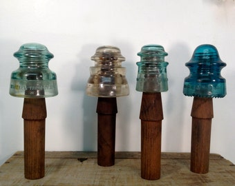 Collection Of Telephone Pole Insulators On Original Wooden Pegs