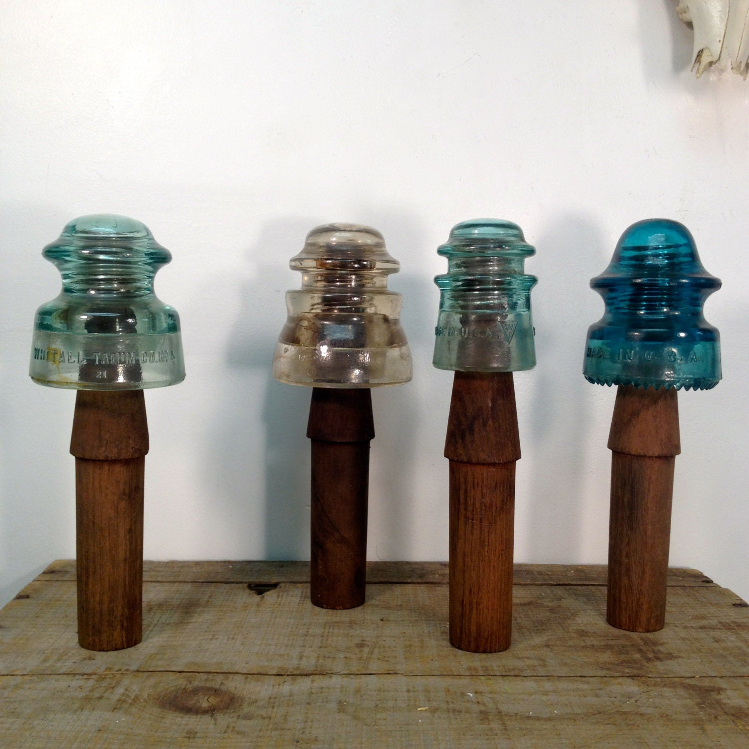 Collection of telephone pole insulators on original wooden for Glass telephone pole insulators