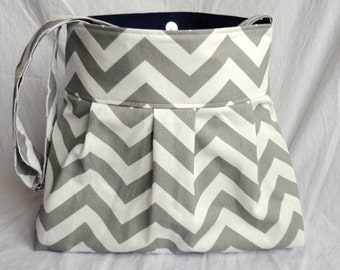 Chevron diaper bag or purse medium in grey and white chevron and navy lining with adjustable strap and elastic bottle pockets