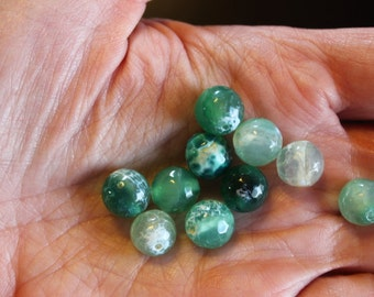 10 natural fire agate beads, green with variations of lighter color, no bead is the same, 10 mm, hole 1 mm , round and faceted