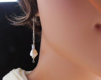 REDUCED Earrings made of large freshwater pearls, crystals, sterling silver ear wires and sterling silver chain.