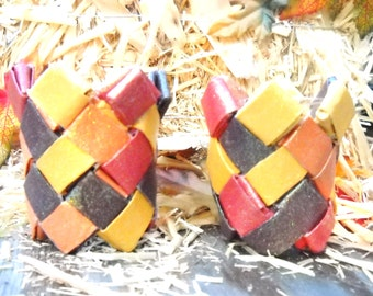 Two tiny Indian corn baskets made of recycled cardboard paper towel tubes - tiny but very strong, sturdy origami baskets -